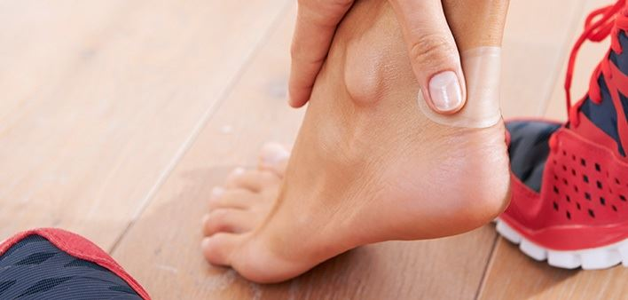 Bare foot with Hansaplast Blister-Plaster to prevent painful blisters